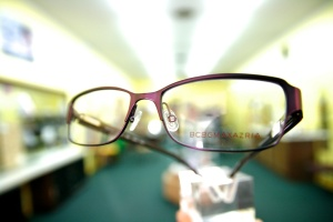 Strange perspective on glasses with blurred background.